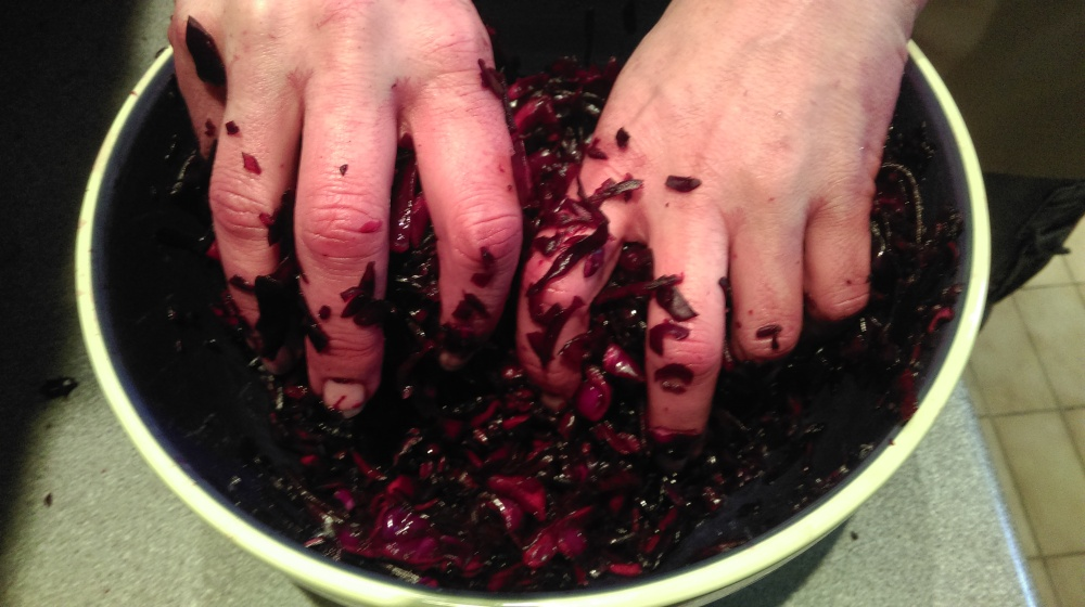 massaging beetroot kraut